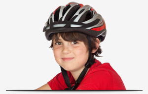 photo of young boy wearing helmet and smiling