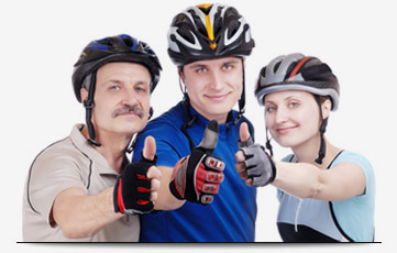 photo of older Cyclists with Helmets and thumbs up